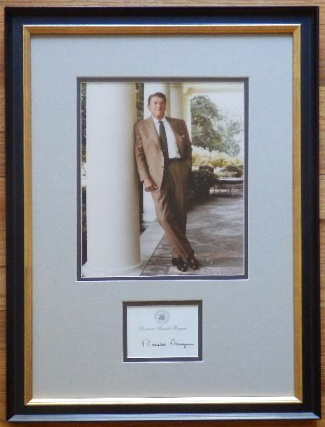 Ronald Reagan Leaning on The White House Column with Signed Post-It-Note