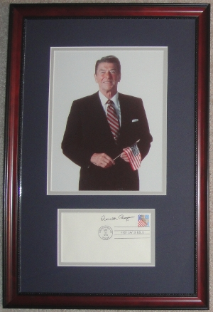 <font size=3>Ronald Reagan Holding an American Flag Display with Signed First Day Cover (FDC)</font>